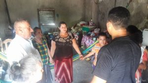 Brother Cecilio shares prayer with a family of Jobal in their home as part of his mission to the people.