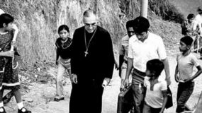 Mons Romero arriving at Nuestra Señora del Lourdes for a pastoral visit shortly before his death.