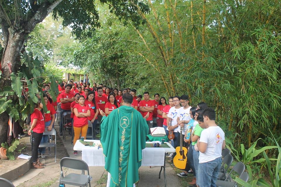 Another view of the young people celebrating Mass with Fr. Luis Jesus Paz, O. Carm., celebrates with the young people on one of the  spiritual weekends in preparation for the pilgrimage to World Youth Day in Panama.